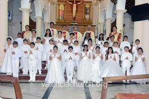 28 Children receive First Holy Communion at Valencia Church